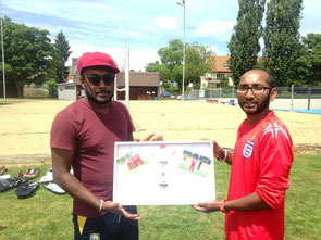 Sahan (l) receives a birthday gift from WCC captain (r)