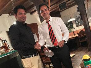 Shijo Joseph (l) receives the best bowler award