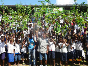 Enthusiastic children with seedlings before planting