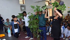 Before planting trees, OISCA staff lectures to students about the meaning of activity and how to plant trees.