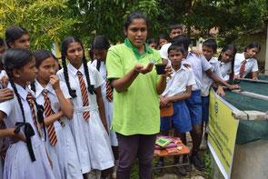 Children express a keen interest in preparing seedlings in pot