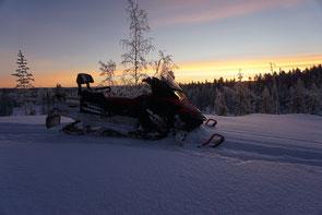 Snowmobile in the sunrise