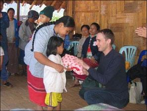 Providing clothing to children from Ban Kwai/Nai Soi and Ban Mae Surin camps