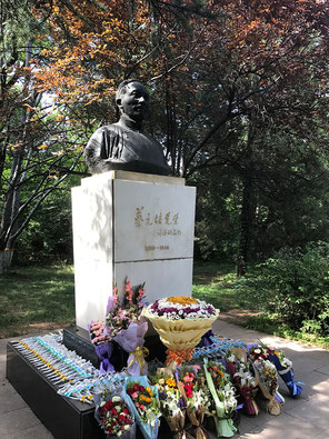 Statue of Prof. Yuanpei Cai on the campus of Peking University decorated with flowers