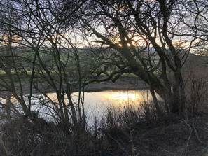 Sunset on River Swale at the bottom of garden