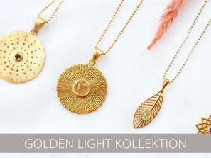 Vergoldeter Symbolschmuck mit Citrin, Mondstein und Smaragd