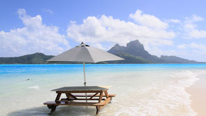Motu picnic in Bora Bora/ white sand beach with Otemanu view