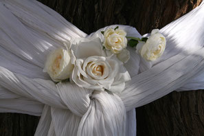 white sheet decorated with white roses