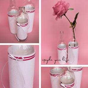 flaschenvasen... einfach ein schönes papier um den unteren teil der flasche kleben, hübsches schleifchen dran... et voila...