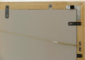 Detail der Rückseite: Die Einrahmung nach konservatorischen Ansprüchen schützt das Gemälde