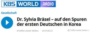Zum Start des Interviewsauf der Seite von KBS World Radio (aus der Reihe 'Treffen zweier Welten'), auf das Logo klicken.