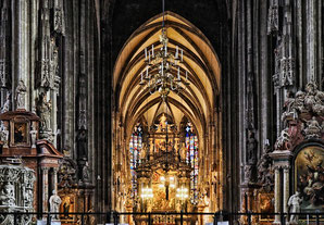 A view through the main nave of the St. Stephen's Cathedral of Vienna to its outstanding altar.