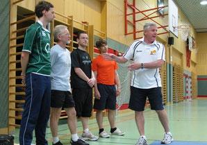 Dennis teaching the boys a lesson