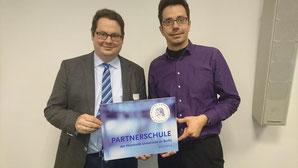 Der Schulleiter, Herr Kötterheinricht-Wedekind, und Herr Paffrath als aktuell Verantwortlicher für die Kooperation