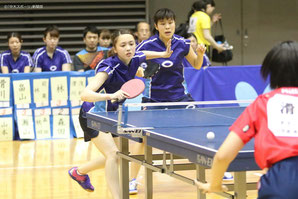 Rei Yamamoto (left) and Yumi Myojin play in a doubles match at the spring Kanto Students Table Tennis League competition.