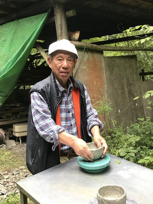 Mr. Haruyoshi Kokaji, a graduate of Chuo University, works on a ceramic bowl at his studio.