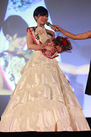 "Haruka Shikishi looks relieved at the end of the ""Miss and Mister Chuo"" pageant in 2014."