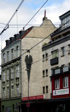Werbung an der Hauswand