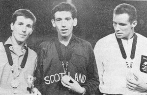 Jim Alder with his gold medal at the 1966 Games flanked by Bill Adcocks (England) and Mike Ryan (New Zealand)