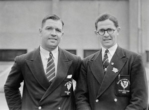 Scotland's gold-medal winner Duncan Clark in team uniform with (I think) fellow athlete John Hart.