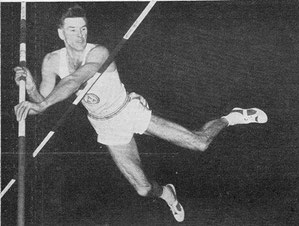 Norman Gregor seen here setting a new British indoor record of 12ft 10in at Wembley (photo by H.W. Neale)