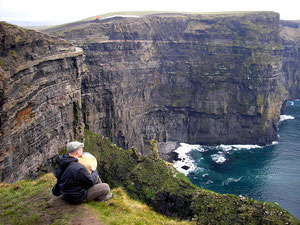 Playing at the Cliffs of Moher, Co. Clare
