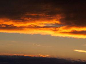 Et profiter malgré ou grâce aux gros nuages noirs au-dessus de nos têtes d'un bien joli coucher de soleil