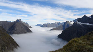View from Gertrude Saddle. Milford Sound and Tasman Sea below clouds.