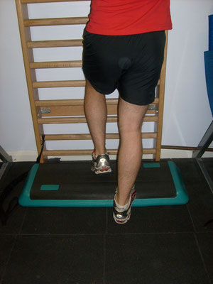 Lower your heel down with the painful leg