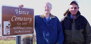 Vera Wheeler and Richard Russell, members of the cemetery board of trustees, accept a new sign for the Vance Cemetery donated by theMcDonough County Historical Society.