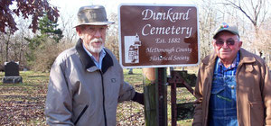 Arlin Fentem (left), who mowed the area as a young boy, and Merle Parks, have grandparents in Dunkard Cemetery and both serve as trustees.