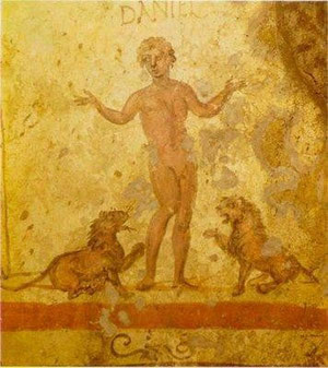 Daniel en el foso de los leones., representado como acróbata circense.