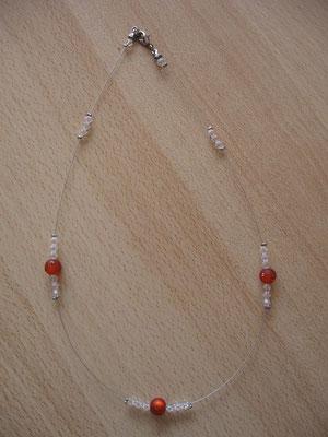 Modèle 21 : longueur 46 cm, toupies swarowski, perles rondes mates incrustées : 6 euros.