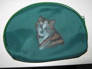 Wer außer mir hat schon seine Katze als Wächter auf dem Geldtäschchen?