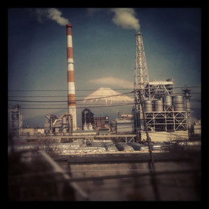Mt.Fuji which is visible between chimneys