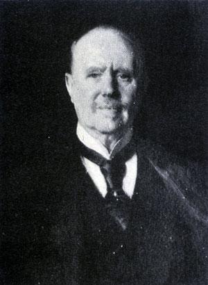 Sir Thomas Sutherland, premier Président de la banque.