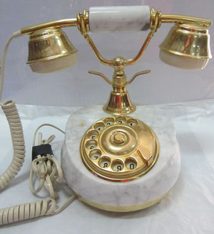 Teléfono alabastro dorado