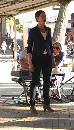 "Singing ""The Composer's Aria"" accompanied by Robert Mills in the Taos Plaza"
