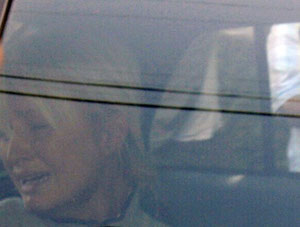 Nick Ut, Paris Hilton is seen through the window of a police car as she is transported from her home to court by the Los Angeles County Sheriff's Department in Los Angeles on Friday, June 8, 2007, 2007. Chromogenic print. © Associated Press/Nick Ut.