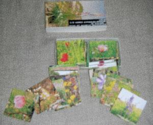 Flou dû à mon APN qui ne fonctionne plus aussi bien qu'avant!! 67 vignettes représentant les fleurs s'épanopuissant sur le causse du Larzac,plus celle du couvercle de la boîte...