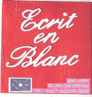 mots découpés blancs sur peinture rouge (acrylique)