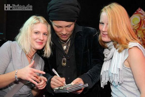 Guido Goh signing his album to fans
