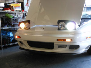 99 LOTUS ESPRIT TWIN TURBO HID HEADLIGHT CONVERSION ON THE LEFT SIDE DISPLAYS OLD AND NEW ON THE RIGHT.