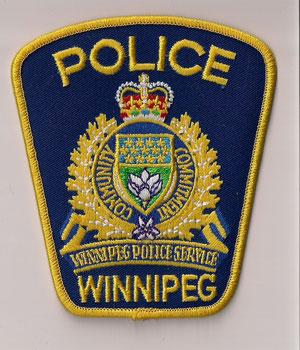 Police Winnipeg  (Ancien modèle / Obsolete)  (Fond bleu / Blue background)  (Neuf / New)  1x