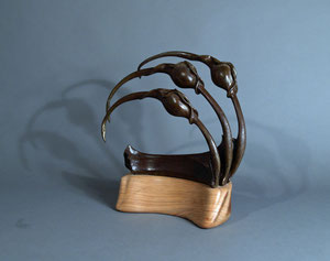 Bronze Sculptural Piece on shaped walnut base.