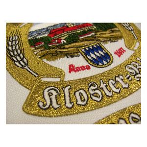 Detailansicht vom gestickten Wappen