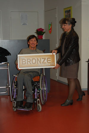 Dominique Grespier avec le label de bronze.