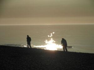 Zachód słońca na plaży w Ustce.
