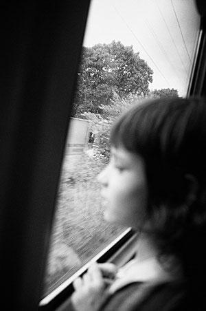 LATVIA / Riga / From the book 'Auftakt'. Little girl looks in train window, 2008