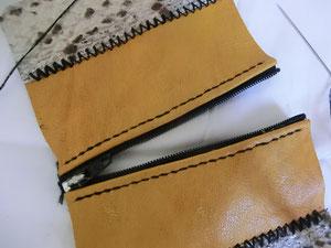 Couture fermeture sur porte-monnaie en cuir. Au fil de Coline, création d'accessoires en cuir de récupération. Fait main à Montpellier